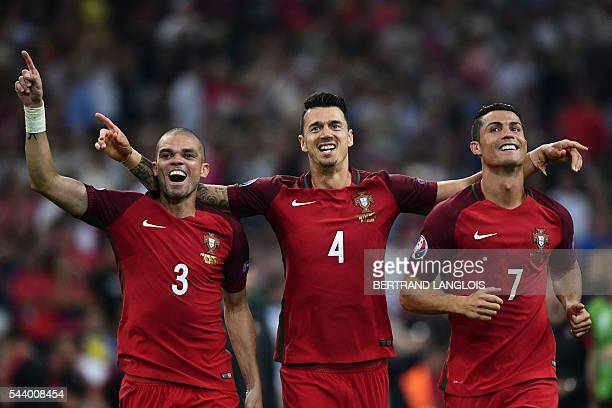 TOPSHOT Portugal's defender Pepe Portugal's defender Fonte and Portugal's forward Cristiano Ronaldo celebrate after winning the Euro 2016...