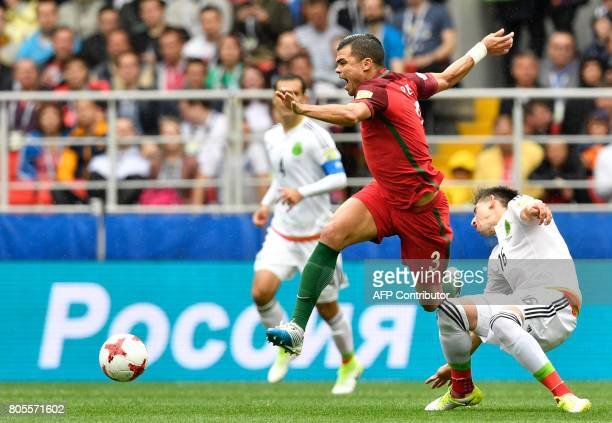 Portugal's defender Pepe reacts as he is challenged by Mexico's midfielder Hector Herrera during the 2017 FIFA Confederations Cup third place...