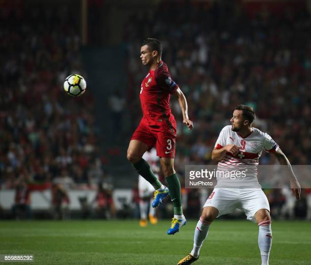 Portugal's defender Pepe vies with Switzerland's forward Haris Seferovic during the FIFA 2018 World Cup Qualifier match between Portugal and...
