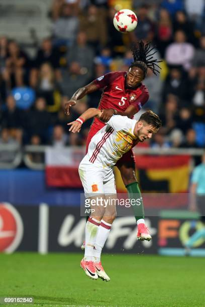 Portugal's defender Ruben Semedo headers the ball over Spain's midfielder Saul Niguez Esclapez during the UEFA U21 European Championship Group B...