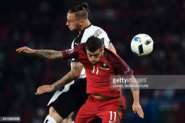 TOPSHOT Portugal's defender Vieirinha and Austria's forward Marko Arnautovic vie for the ball during the Euro 2016 group F football match between...