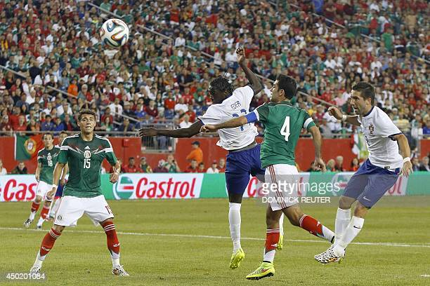Portugal's Éder takes a header on goal during an international friendly soccer match between Mexico and Portugal at Gillette Stadium June 6 in...
