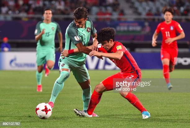 Portugal's Diogo Goncalves fights for the ball with South Korea's Yoon JongGyu during the FIFA Under 20 World Cup round of 16 football match in...