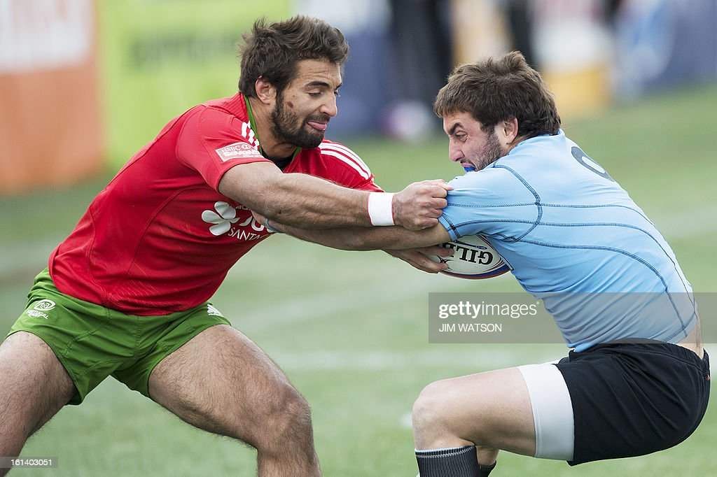 Portugal's Duarte Moreira (L) vies with Uruguay's Santiago Gibernau during Day 3 of the USA Sevens Las Vegas HSBC Sevens World Series Round 5 at Sam Boyd Stadium in Las Vegas, NV, February 10, 2013. AFP PHOTO/Jim WATSON
