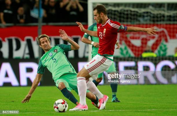 Portugal's Fabio Coentrao in action against Hungary's Marton Eppel during the FIFA World Cup 2018 qualification football match between Hungary and...