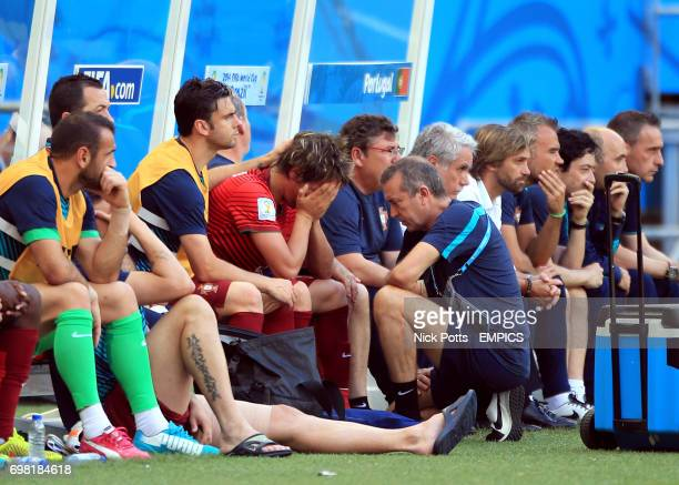 Portugal's Fabio Coentrao sits on the bench after being substituted