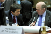 Portugal's Finance minister Vitor Gaspar and Irish counterpart Michael Noonan talk prior to an Economic and Financial Affairs Council on March 5 2013...