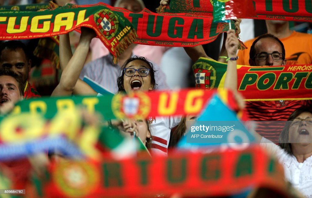 Portugals football fans celebrate at the end of the FIFA World Cup 2018 Group B qualifier football match between Portugal and Switzerland at the Luz Stadium in Lisbon on October 10, 2017. /