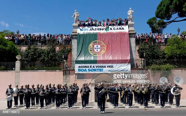Portugal's football players listen to the national anthem on the balcony of the Belem Palace as they celebrate their victory on July 11 2016 after...