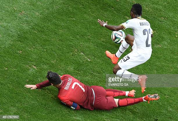 Portugal's forward and captain Cristiano Ronaldo and Ghana's defender Harrison Afful vie for the ball during the Group G football match between...