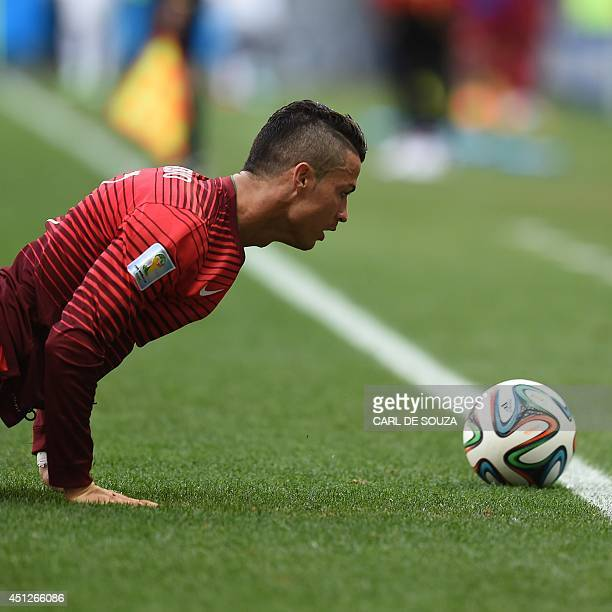 Portugal's forward and captain Cristiano Ronaldo pushes himself up off the ground during the Group G football match between Portugal and Ghana at the...