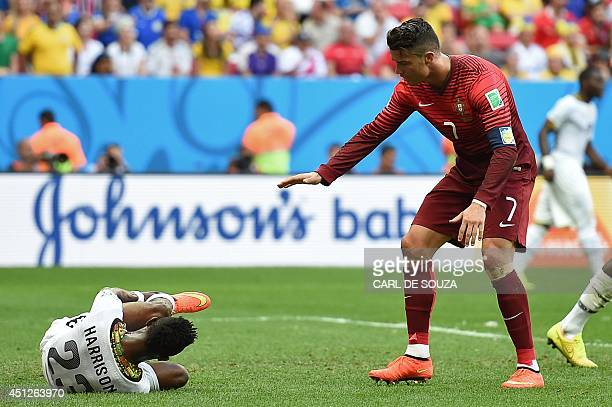 Portugal's forward and captain Cristiano Ronaldo reacts after Ghana's defender Harrison Afful fell to the ground during the Group G football match...