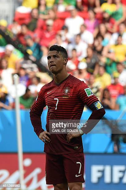 Portugal's forward and captain Cristiano Ronaldo reacts at the end of the Group G football match between Portugal and Ghana at the Mane Garrincha...