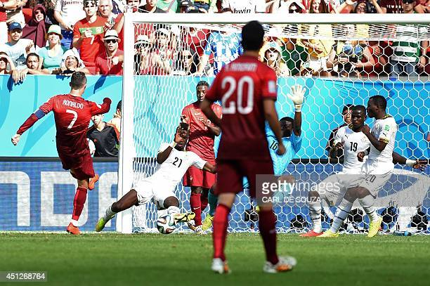 Portugal's forward and captain Cristiano Ronaldo scores a goal during the Group G football match between Portugal and Ghana at the Mane Garrincha...