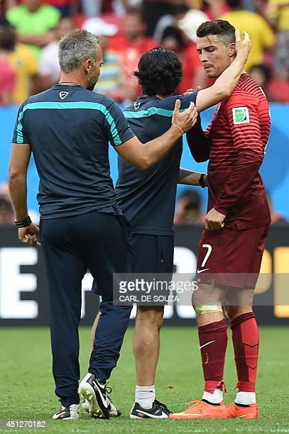 Portugal's forward and captain Cristiano Ronaldo shakes hands with member of the Portugal training team at the end of the Group G football match...
