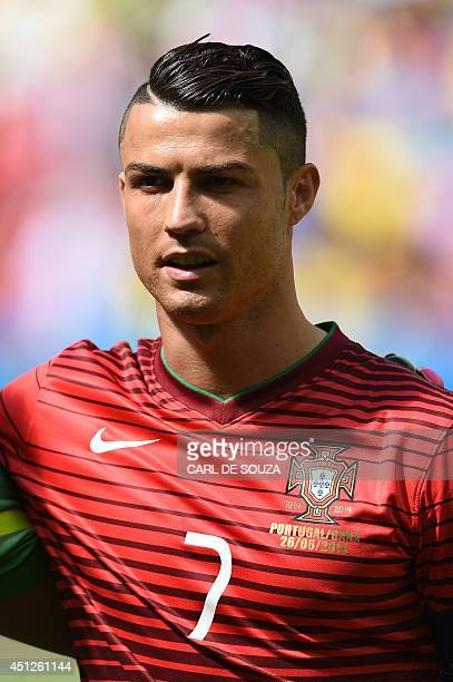 Portugal's forward and captain Cristiano Ronaldo sings his national anthem prior to the Group G football match between Portugal and Ghana at the Mane...