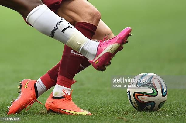 Portugal's forward and captain Cristiano Ronaldo strikes the ball during the Group G football match between Portugal and Ghana at the Mane Garrincha...