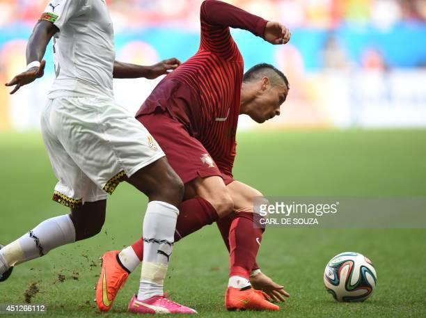 Portugal's forward and captain Cristiano Ronaldo vies for the ball during the Group G football match between Portugal and Ghana at the Mane Garrincha...