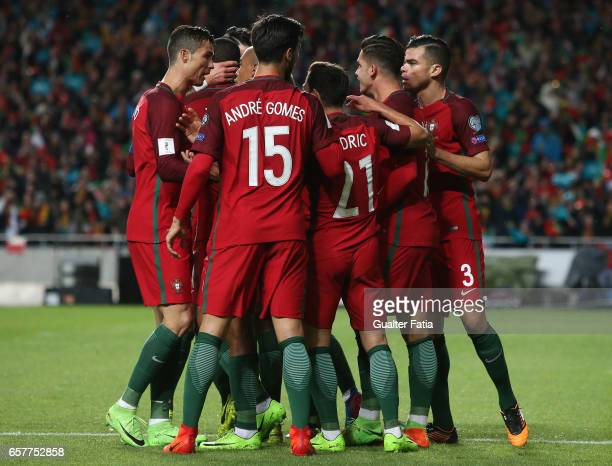 Portugal's forward Andr Silva celebrates with teammates after scoring a goal during the FIFA 2018 World Cup Qualifier match between Portugal and...
