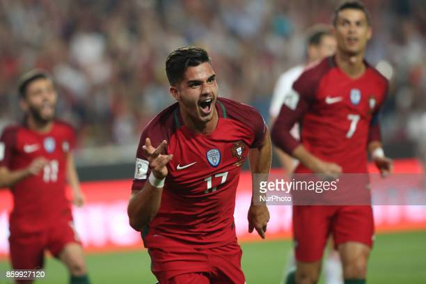 Portugal's forward Andre Silva celebrates after scoring a goal during the 2018 FIFA World Cup qualifying football match between Portugal and...