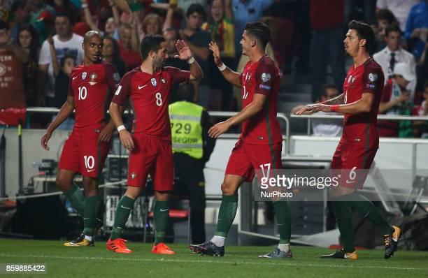 Portugal's forward Andre Silva celebrates with Portugal's defender Jose Fonte Portugal's midfielder Joao Moutinho and Portugal's midfielder Joao...