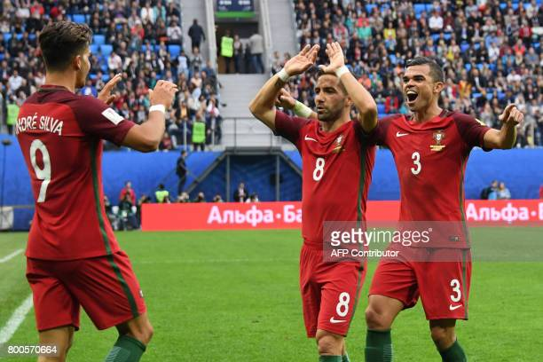 Portugal's forward Andre Silva celebrates with Portugal's defender Pepe and Portugal's midfielder Joao Moutinho after scoring a goal during the 2017...
