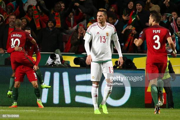Portugal's forward Andre Silva celebrates with team mates after scoring during the football match between Portugal and Hungary at Luz Stadium in...