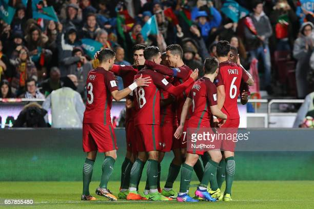 Portugals forward Andre Silva celebrating with is team mate after scoring a goal during Portugal v Hungary FIFA 2018 World Cup Qualifier at Estadio...
