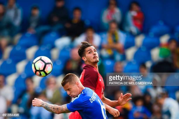 Portugal's forward Andre Silva heads the ball with Cyprus' defender Jason Demetriou during the friendly football match Portugal vs Cyprus at Coimbra...