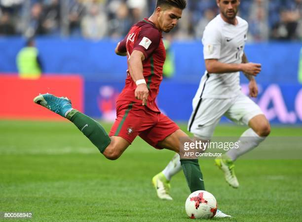 Portugal's forward Andre Silva kicks to score a goal during the 2017 Confederations Cup group A football match between New Zealand and Portugal at...