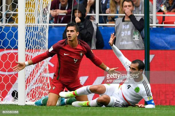 Portugal's forward Andre Silva reacts after being fouled by Mexico's defender Rafael Marquez in the penalty area during the 2017 FIFA Confederations...