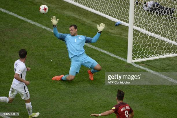 Portugal's forward Andre Silva scores a goal past New Zealand's goalkeeper Stefan Marinovic during the 2017 Confederations Cup group A football match...