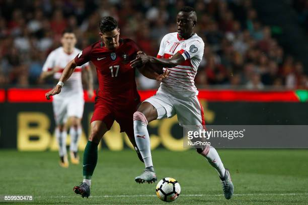 Portugal's forward Andre Silva vies for the ball with Switzerland's midfielder Denis Zakaria during the FIFA World Cup WC 2018 football qualifier...