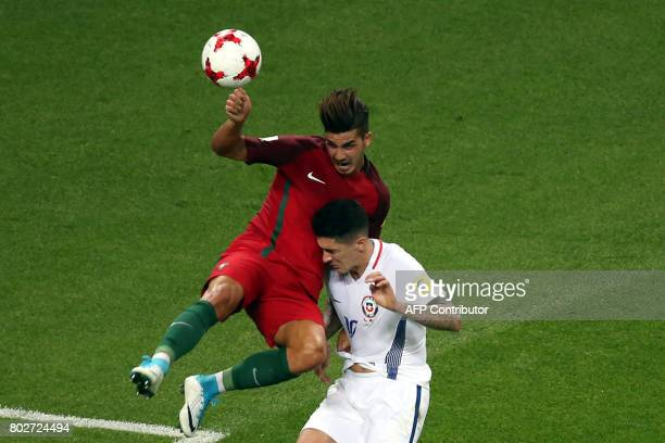 Portugal's forward Andre Silva vies with Chile's midfielder Pablo Hernandez during the 2017 Confederations Cup semifinal football match between...