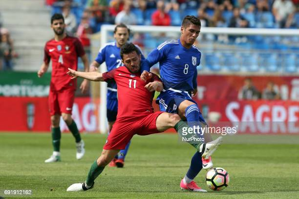 Portugal's forward Bernardo Silva fights for the ball with Cypruss Forward Pieros Sotiriou during the friendly football match Portugal vs Cyprus at...