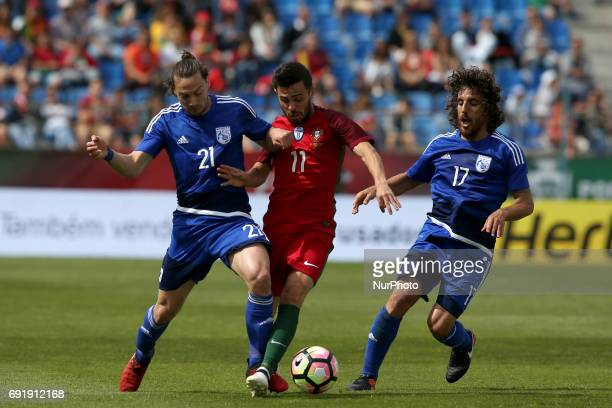Portugal's forward Bernardo Silva fights for the ball with Cypruss Forward Andreas Makris and Cypruss midfielder Renato Margaca during the friendly...