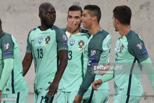 Portugal's forward Cristano Ronaldo celebrates with his teammates after scoring a goal during the FIFA World Cup 2018 football qualifier between...