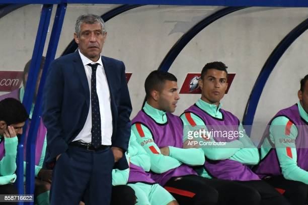 Portugal's forward Cristiano Ronaldo and Portugal's head coach Fernando Santos look on during the FIFA World Cup 2018 football qualifier between...