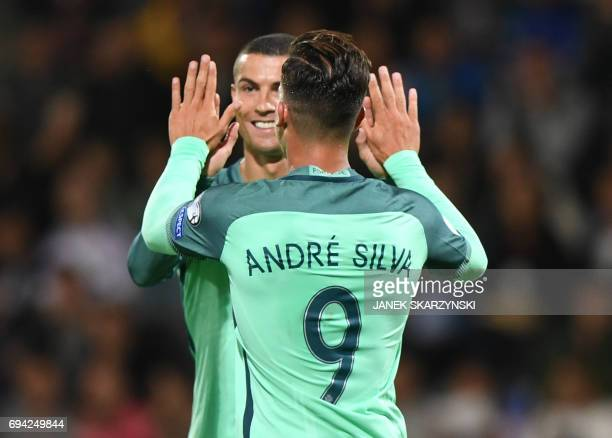 Portugal's forward Cristiano Ronaldo and Portugal's midfielder Andre Silva celebrate scoring during the FIFA World Cup 2018 qualification football...
