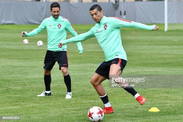 Portugal's forward Cristiano Ronaldo and Portugal's midfielder Joao Moutinho take part in a training session in Saint Petersburg on June 23 2017 on...