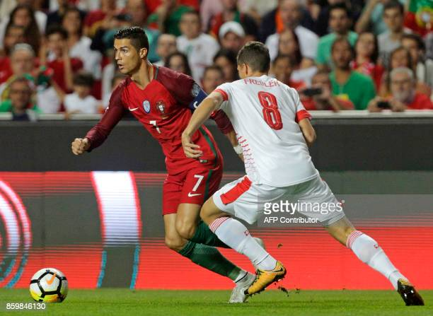 Portugals forward Cristiano Ronaldo and Swiss midfielder Remo Freuler vie for the ball during the FIFA World Cup 2018 Group B qualifier football...