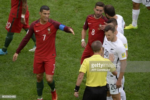 Portugal's forward Cristiano Ronaldo argues with the referee during the 2017 Confederations Cup group A football match between New Zealand and...
