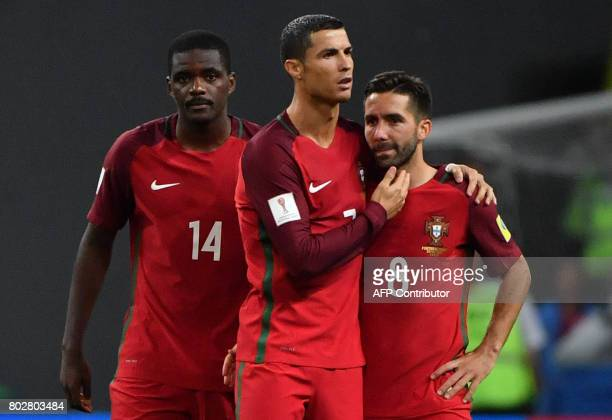 Portugal's forward Cristiano Ronaldo C Portugal's midfielder William and Portugal's midfielder Joao Moutinho react after their defeat during the 2017...