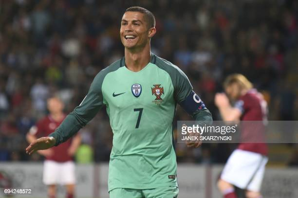 Portugal's forward Cristiano Ronaldo celebrate scoring during the FIFA World Cup 2018 qualification football match between Latvia and Portugal in...