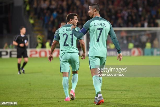 Portugal's forward Cristiano Ronaldo celebrate scoring with Portugal's defender Cedric Soares during the FIFA World Cup 2018 qualification football...