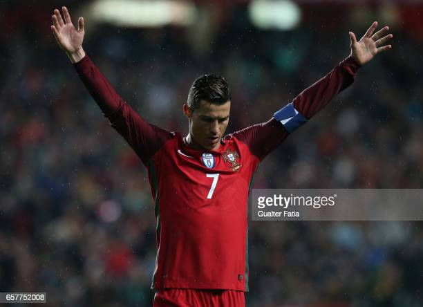 Portugal's forward Cristiano Ronaldo celebrates after scoring a goal during the FIFA 2018 World Cup Qualifier match between Portugal and Hungary at...