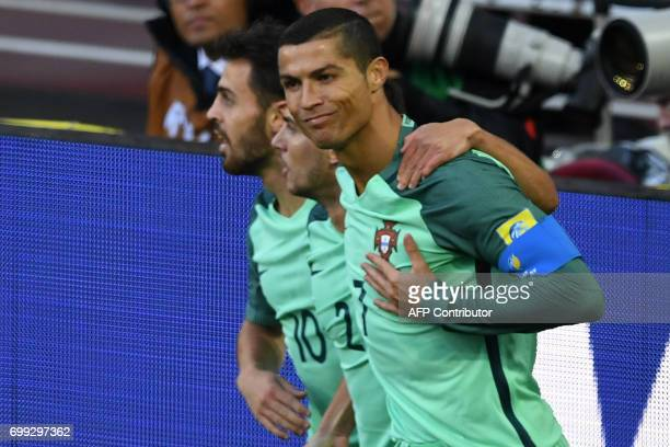 Portugal's forward Cristiano Ronaldo celebrates after scoring a goal during the 2017 Confederations Cup group A football match between Russia and...