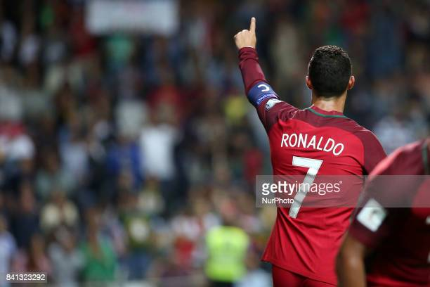 Portugal's forward Cristiano Ronaldo celebrates after scoring a goal during the 2018 FIFA World Cup qualifying football match between Portugal and...