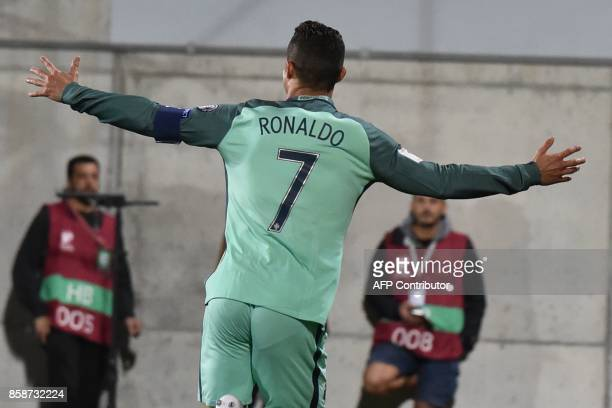 TOPSHOT Portugal's forward Cristiano Ronaldo celebrates after scoring a goal during the FIFA World Cup 2018 football qualifier between Andorra and...
