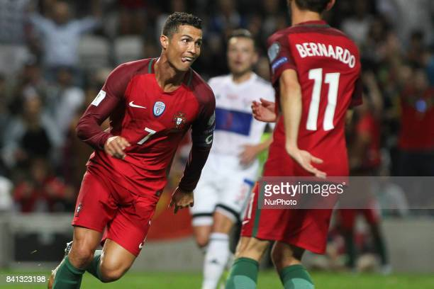 Portugal's forward Cristiano Ronaldo celebrates after scoring goal during the FIFA World Cup Russia 2018 qualifier match between Portugal and Faroe...